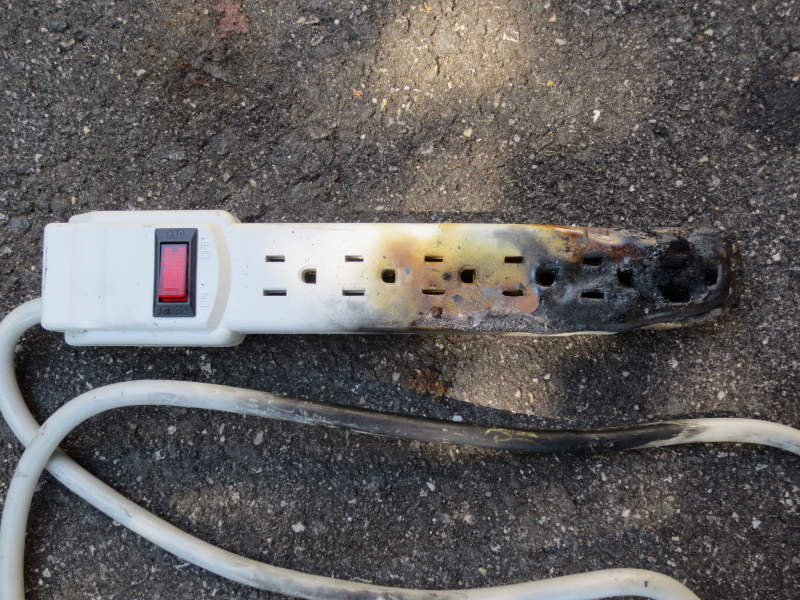 Burnt and melted power strip